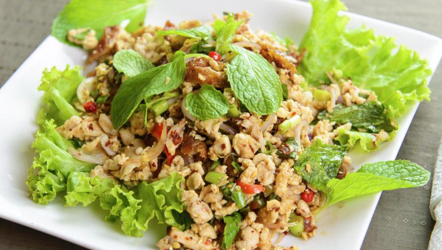Thai style chicken salad served on white plate